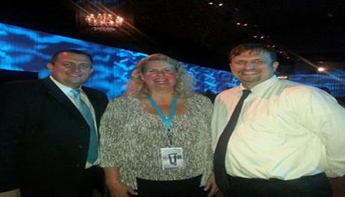 Ark Rusak - <pre>Rob Rusak, Nancy Alexander, Ark Rusak at Farmers® Ins Championship Convention</pre>