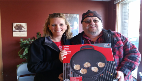 Angela VanderVinne - <pre>Bob picking up his prize @ the office from the QCA RV/Camping</pre>