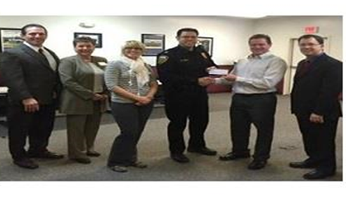 Allen Weaver - <pre>Weaver Team delivering a check for $2550.00 to install a speed monitor</pre>