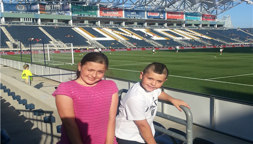 Brian Baker - <pre>Summer and Tyler at the Philadelphia Union vs NY Cosmos soccer match.</pre>