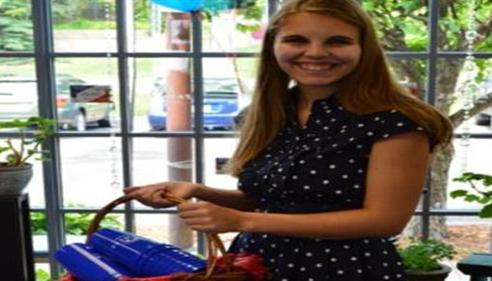 Bonnie Perkins - <pre>Nicole handing out Farmers® cups at our 11th Annual Ice Cream Social</pre>