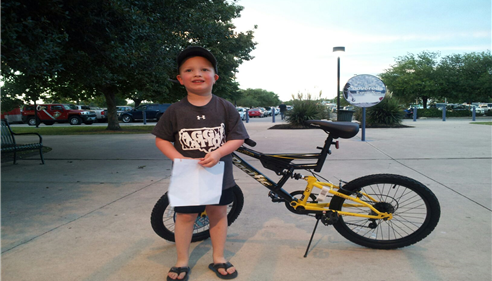 J. Ben Warthan - <pre>Our bike winner at the San Antonio Missions baseball game.</pre>