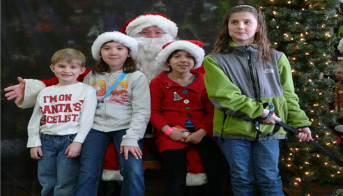 Jennifer Gregorski - <pre>The office employees kids and Santa.</pre>
