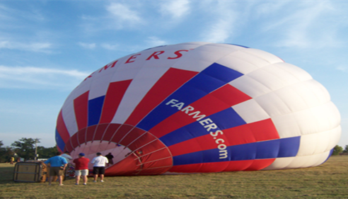 John Ogden - <pre>Blowing up the Farmers® hot air balloon at the LPGA Tournament.</pre>