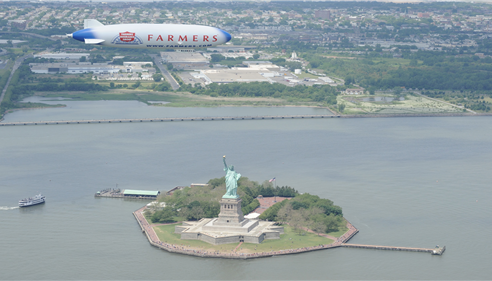 Jodi Strohm - <pre>Farmers® Insurance blimp over NY City</pre>