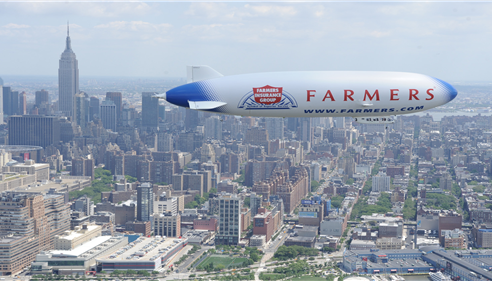 Jodi Strohm - <pre>Farmers® Insurance blimp flying over NY City</pre>