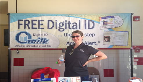 Kristine Avram - <pre>Erin Rogers at the Avram Booth for digital photos and fingerprinting.</pre>