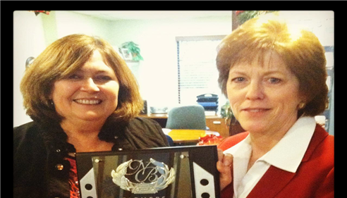 Karen Caldwell - <pre>Karen and Emily proudly holding our Farmers New Business Award!</pre>