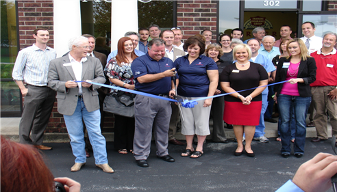 Kenny Teague - <pre>Ribbon cutting at the opening of The Ken Teague Agency.</pre>