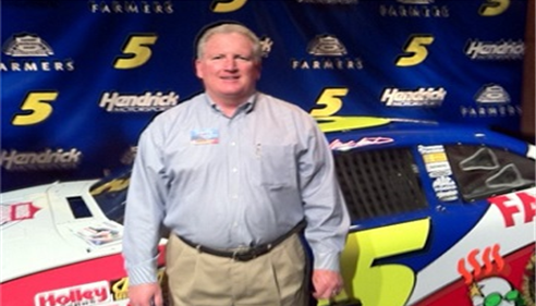 Larry Novak - <pre>Farmers® is part of the Hendrick Racing Team. Larry Novak, 2011.</pre>