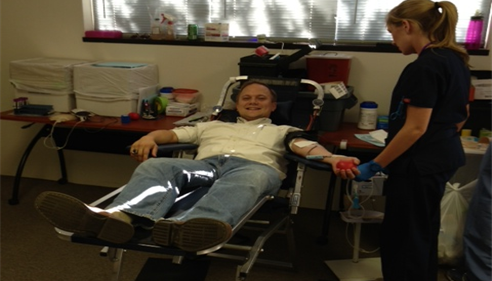 Mike Schmisek - <pre>Agent Mike Schmisek donating blood</pre>