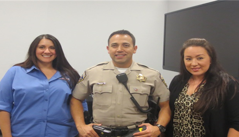 Melissa Watanabe - <pre>Cynthia Varnell of Gustafson Bros Automotive, Officer Ray Payton and Agent Melissa Watanabe at a Teen Driver Safety workshop in Oct. 2013</pre>