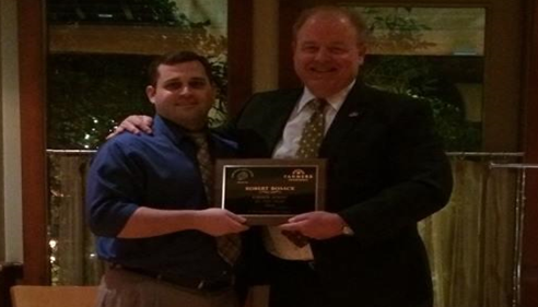 Robert Bosack - <pre>With my district manager Kevin, receiving agent of the year award.</pre>