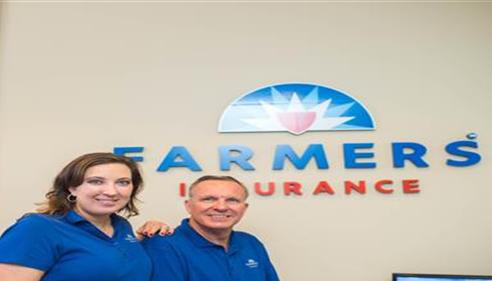 Richard Winters - <pre>Rich Winters with Jennifer Winters-Riggs with their new Farmers® sign and logo.</pre>